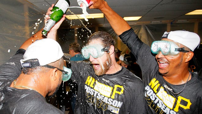 ATLANTA, GA - SEPTEMBER 23:  Francisco Liriano #47, John Axford #53, and Stolmy Pimentel #38 of the Pittsburgh Pirates celebrate clinching a National League playoff spot after their 3-2 win over the Atlanta Braves at Turner Field on September 23, 2014 in Atlanta, Georgia.  (Photo by Kevin C. Cox/Getty Images)