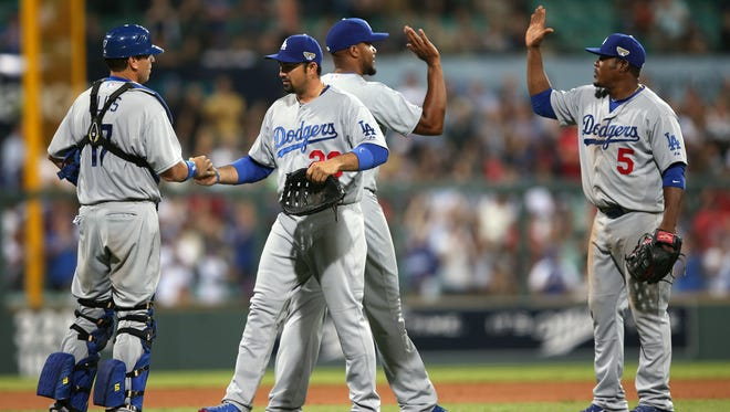 Kenley Jansen finished off a 3-1 Dodgers victory in the 2014 season opener.