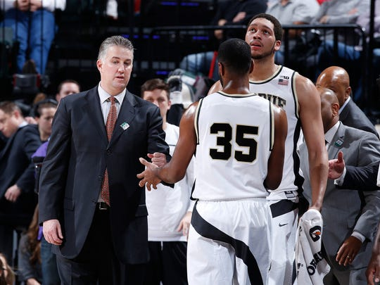 Head coach Matt Painter and A.J. Hammons #20 of the Purdue Boilermakers congratulate Rapheal Davis #35 as he comes to the bench against the Michigan Wolverines in the semifinals of the Big Ten Basketball Tournament at Bankers Life Fieldhouse on March 12, 2016 in Indianapolis, Indiana. Purdue defeated Michigan 76-59.
