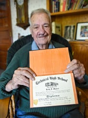 Keith Maurer holds his 1942 graduation certificate from Technical High School Tuesday, May 16, at his home in St. Cloud.