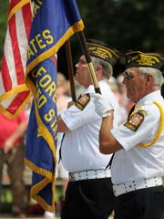 Jim Lang, left, and Dave Gardner march with the VFW