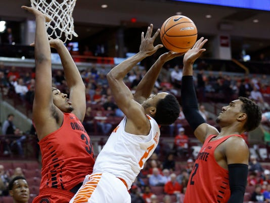 Clemson's Marcquise Reed, center, shoots the ball between Ohio State's Kaleb Wesson, left, and Musa Jallow during the first half of an NCAA college basketball game Wednesday, Nov. 29, 2017, in Columbus, Ohio. (AP Photo/Jay LaPrete)