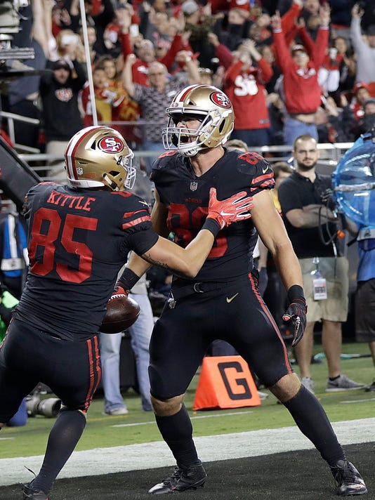 San Francisco 49ers tight end Garrett Celek, right, celebrates with George Kittle (85) after scoring a touchdown against the Los Angeles Rams during the second half of an NFL football game in Santa Clara, Calif., Thursday, Sept. 21, 2017. (AP Photo/Marcio Jose Sanchez)