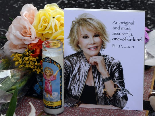 Flowers are placed on the Hollywood Walk of Fame star for Joan Rivers in Hollywood, California on September 4, 2014, following news of the comedian's death in New York at the age of 81.