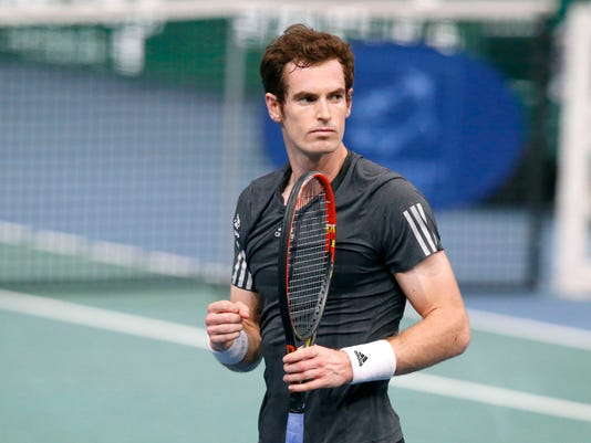 Andy Murray of Britain, celebrates his victory after defeating Grigor Dimitrov of Bulgaria after their third round match at the ATP World Tour Masters tennis tournament at Bercy stadium in Paris, France, Thursday, Oct. 30, 2014. (AP Photo/Michel Euler)