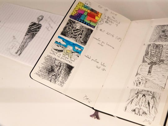 "The ""Blackstar"" Sketchbook is on display during the"