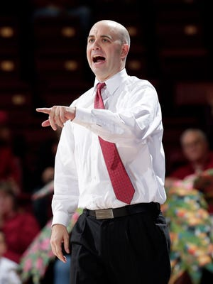 South Dakota head coach Craig Smith instructs his team against Stanford during the second half of an NCAA college basketball game, Sunday, Nov. 16, 2014, in Stanford, Calif. Stanford won 84-73. (AP Photo/Marcio Jose Sanchez)