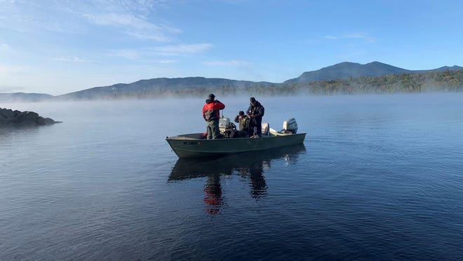 A Maine Warden Service watercraft sets out on Flagstaff Lake to assist in the search for Caitlin Giunta on Monday, Sept. 21, 2020.