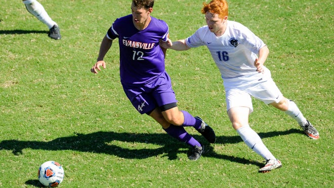 University of Evansville's Zac Blaydes (12) keeps the ball away from Fort Wayne's Will Hunt (16) during the ProRehab Aces Soccer Classic at Arad McCutchan Stadium, Sunday, Sept. 11, 2016. UE beat Fort Wayne 3-1.