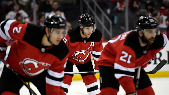Taylor Hall, center, and the Devils defeated the Maple