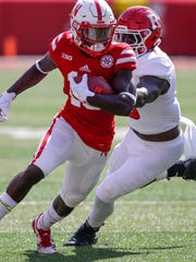 Nebraska wide receiver JD Spielman (10) is chased by Rutgers linebacker Trevor Morris (15) during the first half of an NCAA college football game in Lincoln, Neb., Saturday, Sept. 23, 2017. (AP Photo/Nati Harnik)
