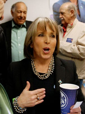 Democratic Congresswoman and gubernatorial candidate Michelle Lujan Grisham talks to political supporters and campaign volunteers at the opening of a campaign office in Santa Fe, N.M., on April 6, 2018.