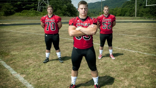 Pisgah junior Michael Parrott, center, has committed to play college football for Alabama.