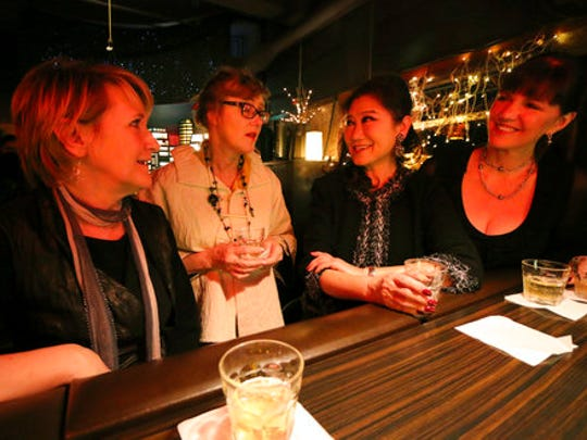 "In this March 10, 2017 photo, Festa bar owner Masae Matsumoto, second right, chats with her customers, nutritionist Cecilia Bell, left, florist designer Connie Brandon, second left, and banker Crystal Roseberry, over Japanese whisky at Festa bar in San Francisco, Calif., thousands of miles (kilometers) away from Japan. Roseberry was trying a Suntory's Yamazaki 12, at $40 a drink, for the first time. ""Soft, silky, not jarring, elegant, friendly. And it still has a structure of a good whisky, which I think is very important,"" she said in an interview over an online call."