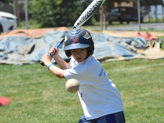 Louis Schultz, 11, of Virginia Beach works on a hitting