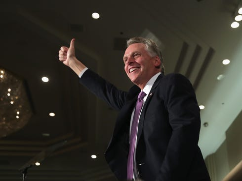 Democrat Terry McAuliffe celebrates winning the Virginia governorship at an election-night party on Tuesday in Tysons Corner, Va.