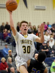 Eastern York high school's Stephen Wisler 30, draws the foul from Kennard Dale's Donnell Williams during the Knights' 51-42 victory over the Rams on Tuesday, Jan. 24, 2017.