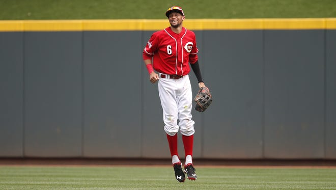 Billy Hamilton celebrates following the Reds' win.