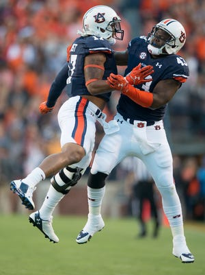 Auburn linebacker Kris Frost celebrates with Auburn linebacker Anthony Swain during Saturday's 41-7 win over LSU.