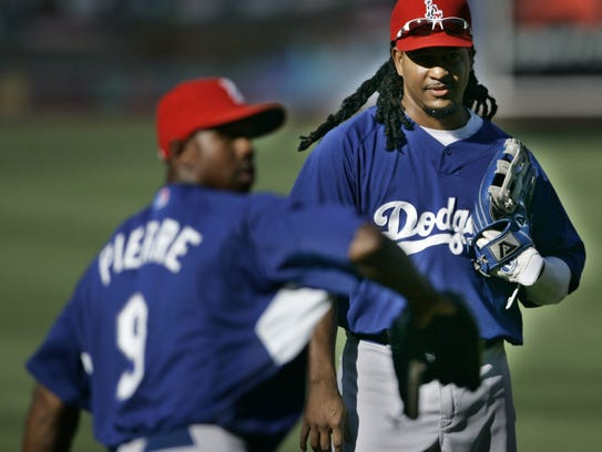 Los Angeles Dodgers' Manny Ramirez, right, watches