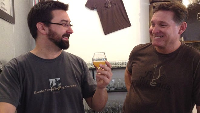Tim Kazules and Neil Shirley of Five Threads Brewing Co. in Westlake Village toast the opening of the business in a photo from October 2015. The brewery's expanded taproom will debut during the second Slainte Fest, a ticketed event from 3:30-11 p.m. March 17.
