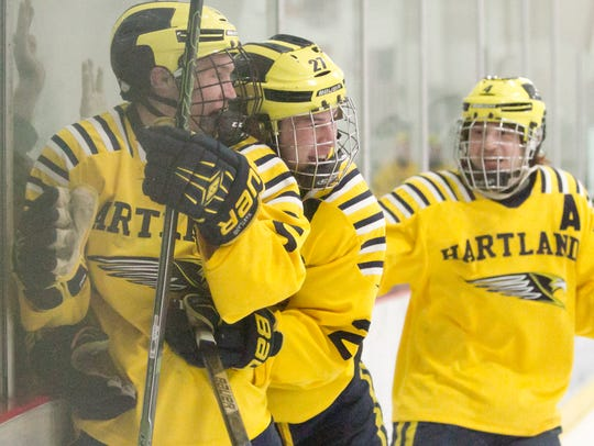 Jed Pietila of Hartland, left, is congratulated by