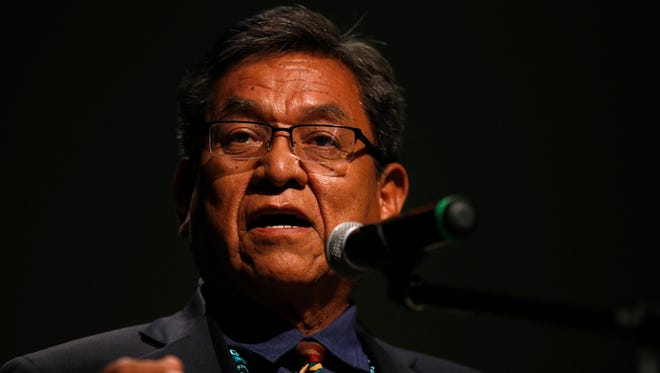 Navajo Nation President Russell Begaye talks with community members on July 20 during a public meeting at the Phil Thomas Performing Arts Center in Shiprock.