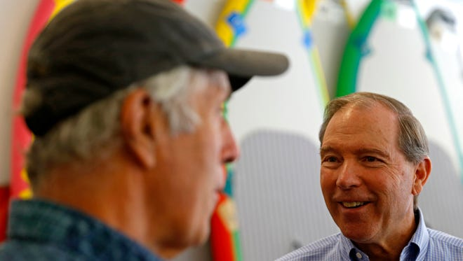 Owner Jack Kloepfer, left, talks about the different products at his shop with U.S. Sen. Tom Udall Friday at Jack's Plastic Welding Inc. in Aztec.