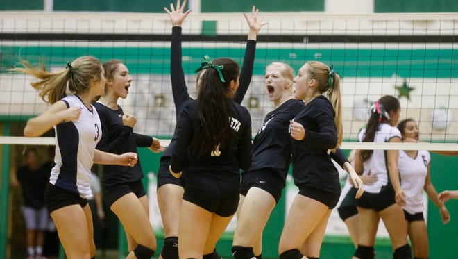The Piedra Vista volleyball team celebrates after scoring a point against Farmington High School during an Oct. 1 match at Scorpion Gym in Farmington.