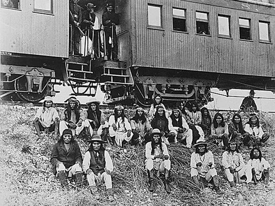 In this 1886 file photo, Apaches are en route to their