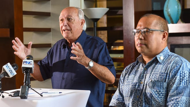 Gubernatorial candidate and former Guam governor, Carl Gutierrez, left, touches upon the status of war reparations during a press conference with his running mate, Fred Bordallo, at the Sheraton Laguna Guam Resort in Tamuning on June 20, 2018.