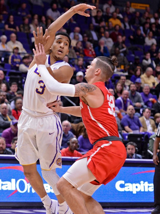 LSU guard Tremont Waters (3) passes over Houston guard Rob Gray (32), during an NCAA college basketball game Wednesday, Dec. 13, 2017, in Baton Rouge, La. (Hilary Scheinuk/The Advocate via AP)