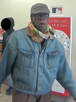 Police are seeking this man in connection with a bank robbery in downtown Camden Friday.
