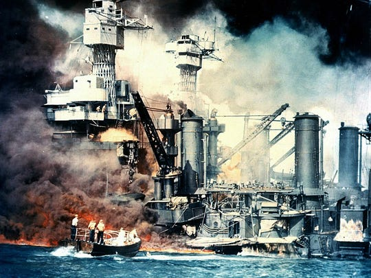 The USS West Virginia burns Dec. 7, 1941, after the surprise attack by Japan on Pearl Harbor. The battleship was sunk but was later salvaged. This December 7, 1941, photo from The National Archives shows the USS West Virginia burning after the surprise Japanese attack on Pearl Harbor, Hawaii.
