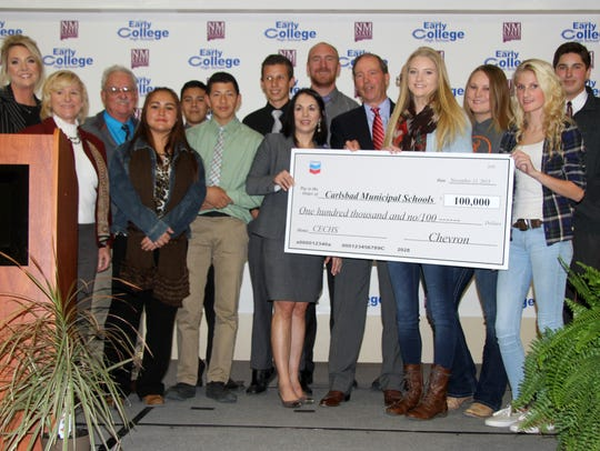 After the program, Chevron presented a $100,000 check
