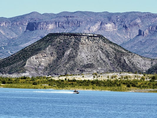 A lake visitor zips across Elephant Butte Lake on a recreational craft on Monday afternoon.