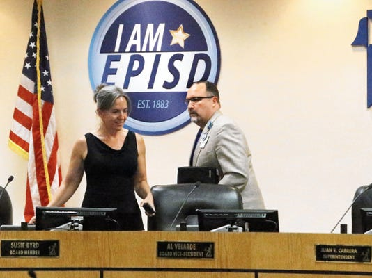 El Paso Independent School District board member Susie Byrd talks with Superintendent Juan Cabrera at the start of EPISD's board meeting Tuesday at district headquarters. It was the trustees' first meeting as an elected board since May 2013.