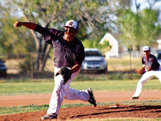 Peter Dindinger — Daily News Toby Carrillo releases a pitch towards home plate on Wednesday evening at the Tularosa High School baseball field.