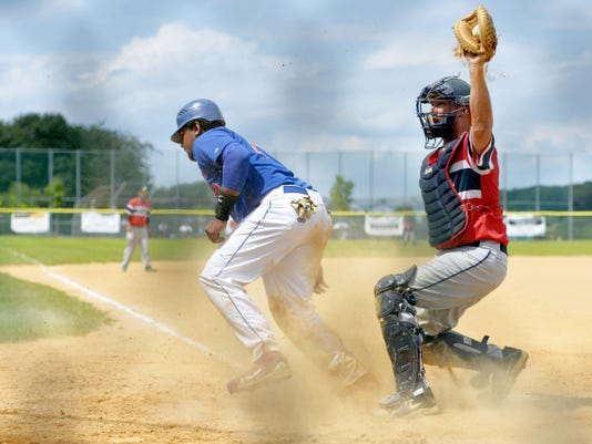 Conrads' Xavier Bonilla slides into an out against Jacobus catcher Eric Hamberger in the fifth inning of a Susquehanna League playoff game on Saturday at Conrads. Jacobus was victorious, 2-1.