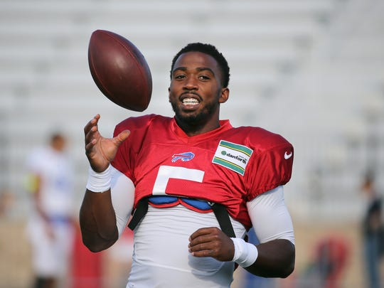 Bills starting quarterback Tyrod Taylor warms up before practice at the Bills Training Camp at St. John Fisher College in August.
