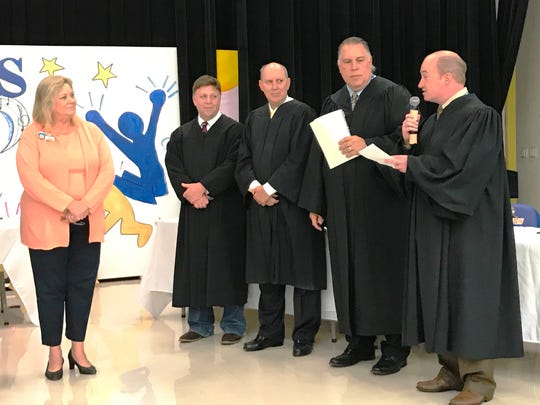 Martin County Schools Superintendent Laurie Gaylord, left, and Judges Alan Forst, Mark Klingensmith, William Roby and Darren Steele at the Center for Constitutional Values Constitution Academic Competition.