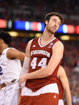 Wisconsin Badgers forward Frank Kaminsky reacts after fouling Duke center Jahlil Okafor during the second half of Monday's NCAA men's basketball tournament final at Lucas Oil Stadium in Indianapolis.