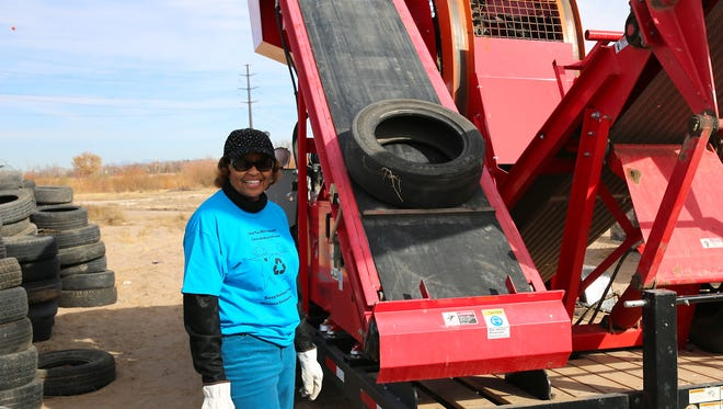 Sunland Park City ManagerJulia Brown lends a hand at the city's tire shredding event.