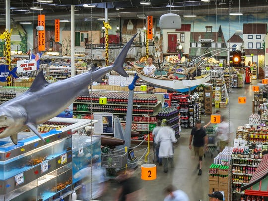Shoppers browse through the wide selection of international foods Jungle Jims in Fairfield has to offer Thursday afternoon. After its start on Dixie Highway in 1975, Jungle Jims celebrates it 40 year anniversary..