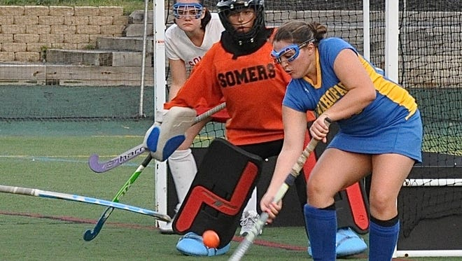 Mahopac's Briana Corace tries to tip shot past Somers goalie Jess Monaco during the Somers Tournament final. Mahopac won 2-1 and Corace had two assists.