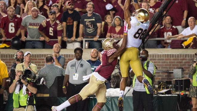 Notre Dame Fighting Irish wide receiver Corey Robinson (88) catches a pass for a touchdown as Florida State Seminoles safety Jalen Ramsey (8) defends in the second quarter at Doak Campbell Stadium. Mandatory Credit: Matt Cashore-USA TODAY Sports