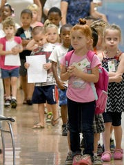 Children participating in kindergarten camp  change classes on Tuesday.