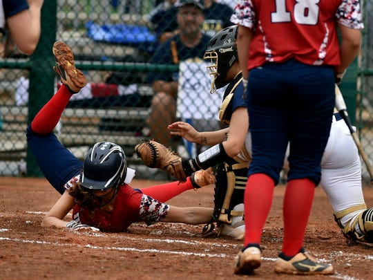 Halle Morgan, of Master's Academy, is tagged out by Kaylie Rogers, catcher for Aucilla Christian, while trying to steal home in the top of the third inning of their Class 2A state semifinal game at Historic Dodgertown on Monday, May 21, 2018, in Vero Beach. Aucilla Christian won the game, 4-0.