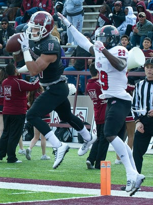 New Mexico State receiver Jordan Bergstrom beats Arkansas State defensive back Chris Humes to the ball in the end zone for an Aggie touchdown in  on Saturday afternoon at Aggie Memorial Stadium.