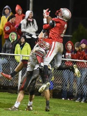 Shelby wide receiver Cody Stine can't hang on to a long pass from Shelby quarterback Brennan Armstrong in first half action against Loudonville on Friday night in Shelby.